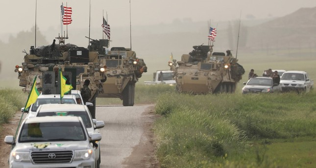 The YPG terrorists heading a convoy of U.S military vehicles in the Syrian town of Darbasiya next to the Turkish border, April 28.