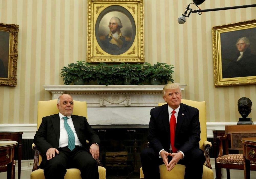 U.S. President Donald Trump meets with Iraqi Prime Minister Haider al-Abadi at the White House in Washington, March 20.