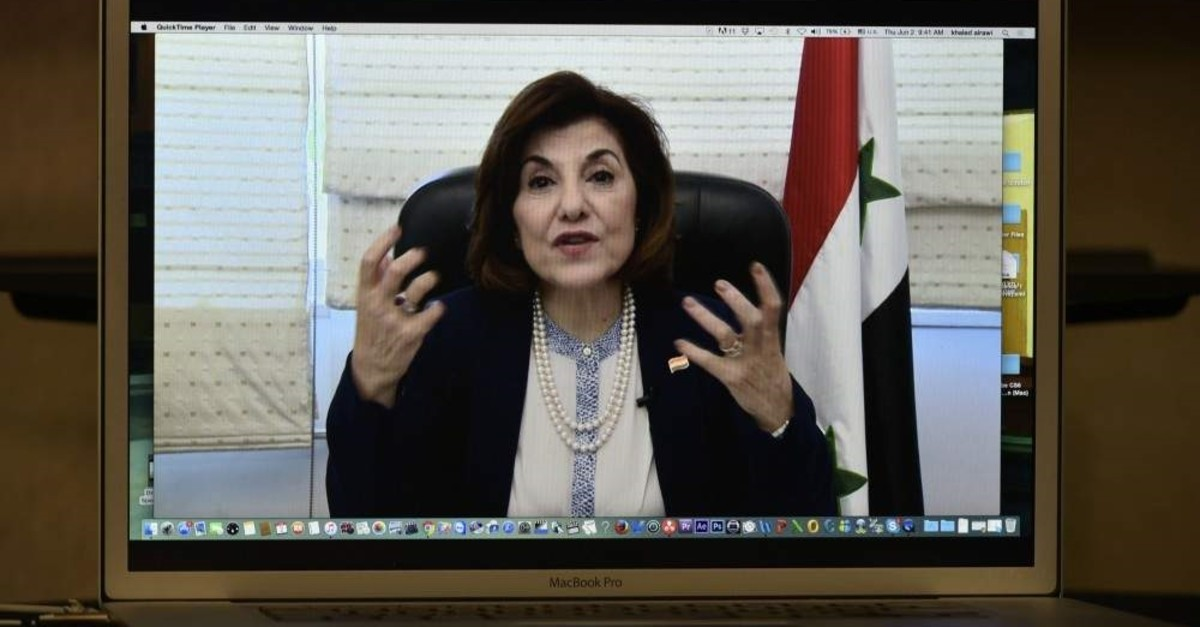 Bouthaina Shaaban, political and media adviser to Bashar Assad, speaks via Skype during a press conference organized by The Global Alliance for Terminating ISIS/Al-Qaida at the National Press Club in Washington, June 2, 2016. (AFP Photo)