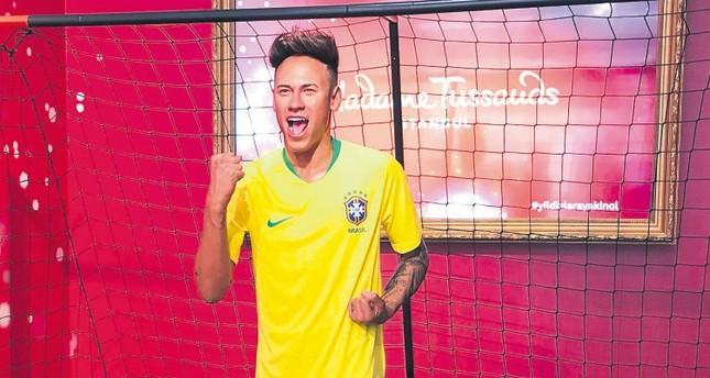 Neymar salutes passersby at Madame Tussauds Istanbul