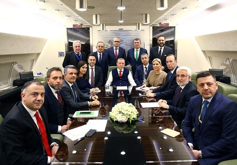 Erdou011fan talks with journalists in the presidential plane. (AA Photo)