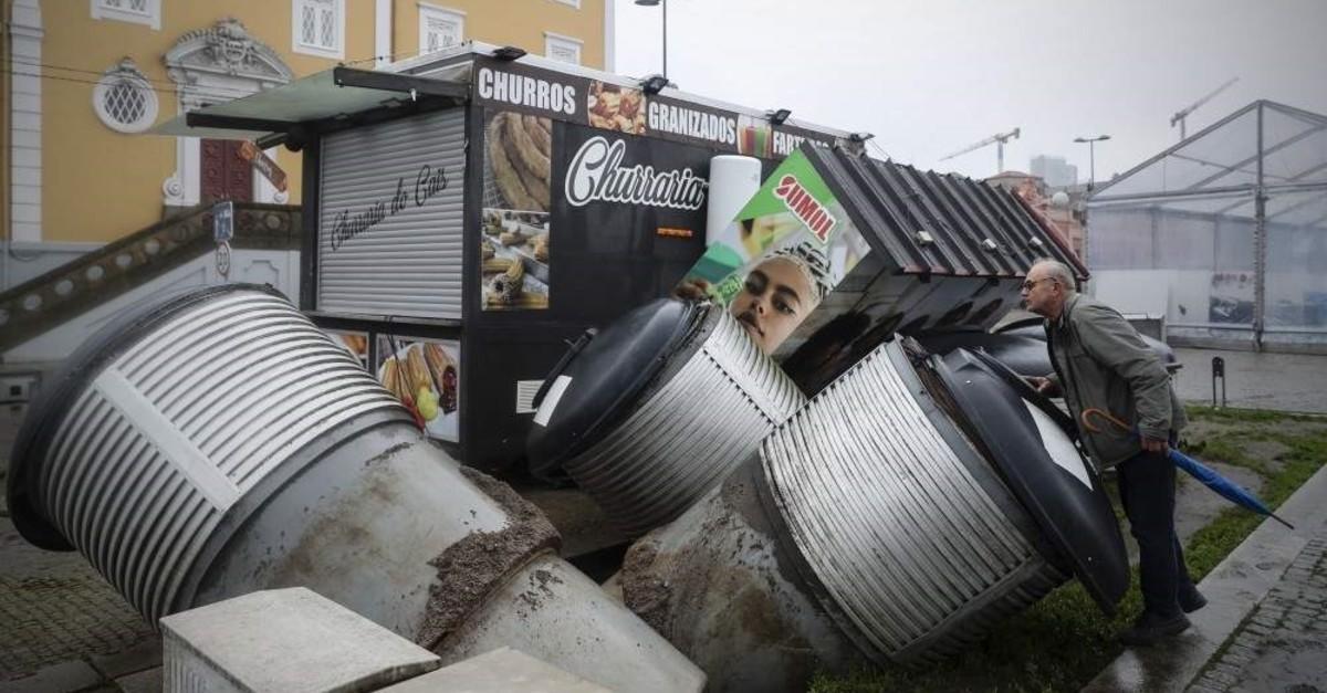 A man examines the damages caused by flooding at Gaia Quay in Vila Nova de Gaia, Portugal, Dec. 21, 2019. (EPA Photo)