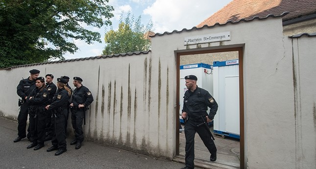 In this Aug. 8, 2016 picture police officers standing in front of the parish hall of St. Emmeram where refugees were living in Regensburg, Germany (AP Photo)