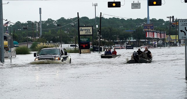 Flood waters from Hurricane Harvey cover the main street in Dickinson, Texas August 27, 2017. (Reuters Photo)