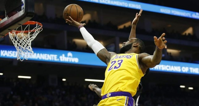 James goes to the basket during an NBA game against Sacramento Kings, Feb. 1, 2020. AP Photo