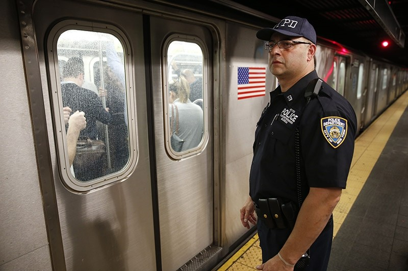 A police officer watches a train pull out of the Times Square subway station in New York, Wednesday, Sept. 17, 2014. (AP Photo)