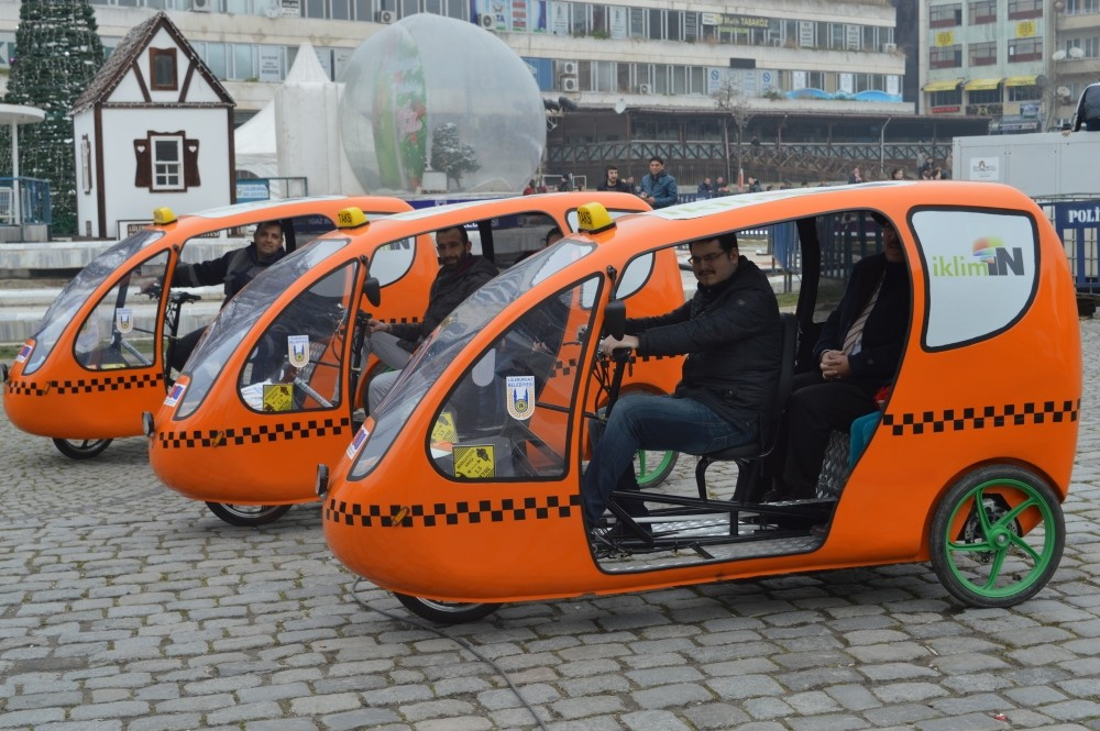 Environment friendly ,cab bikes,, similar to iconic ,tuk tuk,, haul commuters free of charge.