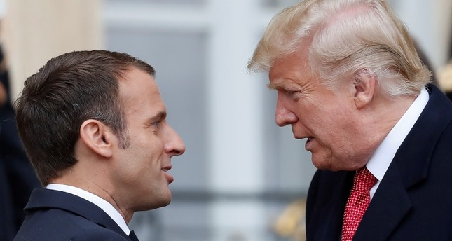 French President Emmanuel Macron (L) greets US President Donald J. Trump (R) upon his arrival at the Elysee Palace in Paris, France, 10 November 2018. (EPA Photo)