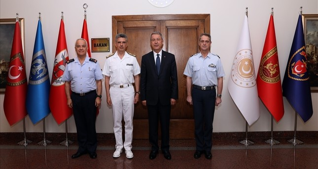 Defense Minister Hulusi Akar (2ndR) poses for a photo with Greek military delegation arriving in Ankara for confidence-building talks. (Photo: Ministry of Defense)