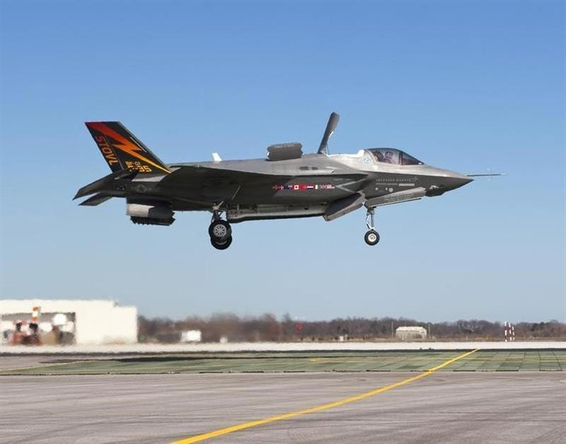 The supersonic Lockheed Martin F-35B Lightning II stealth fighter, piloted by Graham Tomlinson, lands vertically for the first time at Naval Air Station Patuxent River, Maryland on March 18, 2010. (Reuters Photo)