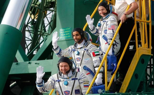 United Arab Emirates astronaut Hazza Al Mansouri, centre, Russian cosmonaut Oleg Skripochka, bottom, and U.S. astronaut Jessica Meir, top, members of the main crew to the International Space Station ISS AP Photo