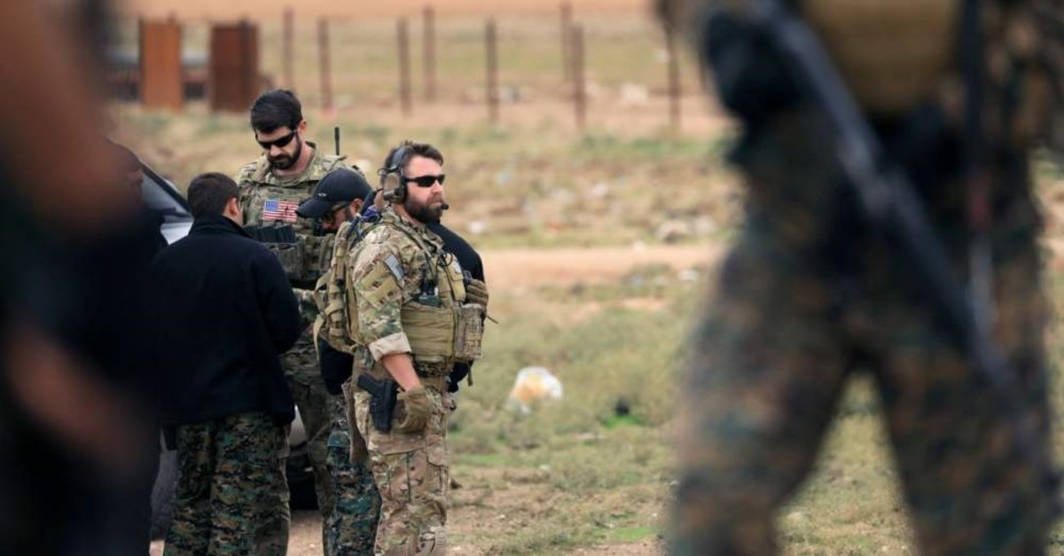 Members of the SDF, an umbrella group dominated by the YPG, and U.S. troops are seen during a patrol near the Turkish border in Syriau2019s Hasakah province, Nov. 4, 2018. (Reuters Photo)