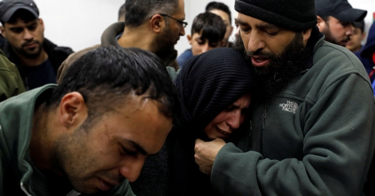 The mother of Palestinian Mohammad Edwan, who was killed during an Israeli raid, is comforted as she reacts at a hospital in Ramallah, in the Israeli-occupied West Bank April 2, 2019. (Reuters Photo)