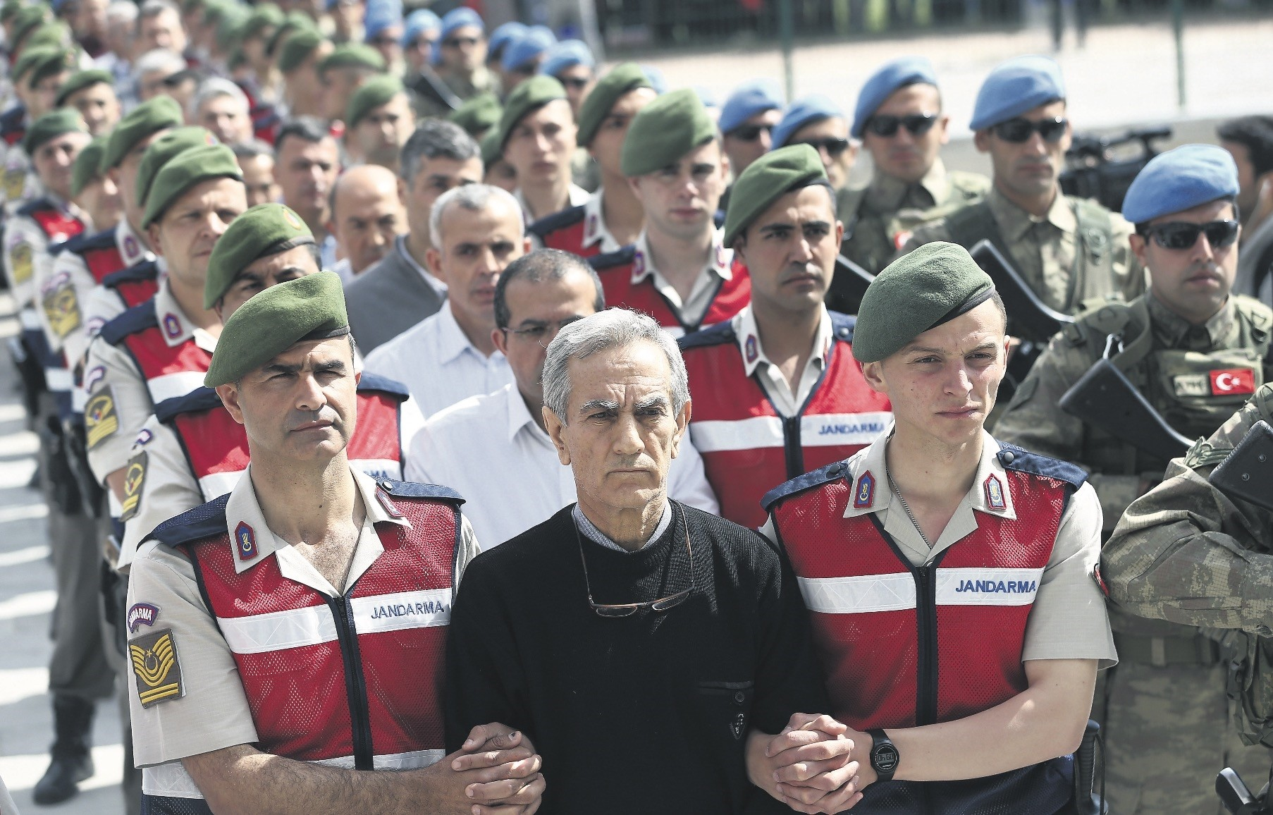 Aku0131n u00d6ztu00fcrk, the former general accused of commanding the putsch attempt and other defendants accompanied by troops at the first hearing of a trial in the capital Ankara in May 2017.
