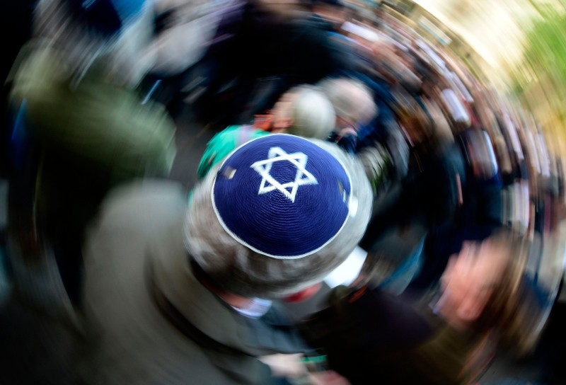 In this file photo taken on April 25, 2018 in Berlin a participant of the ,Berlin wears kippa, rally wears a kippa, organized after a spate of shocking anti-Semitic assaults. (AFP Photo)