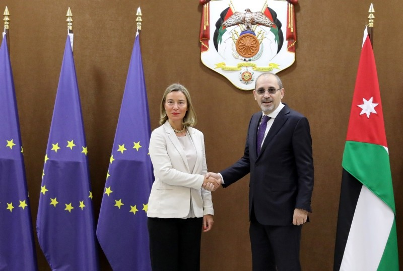 EU High Representative for Foreign Affairs and Security Policy Frederica Mogherini, left, shakes hand with Jordan Foreign Minister Ayman Safadi, at the Foreign Ministry in Amman, Jordan, June 10, 2018. (EPA Photo)