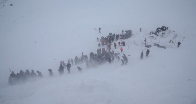 Rescue crews and locals are trying to find those who were trapped underneath snow after an avalanche, in Bahçesaray, Van, eastern Turkey. AA Photo