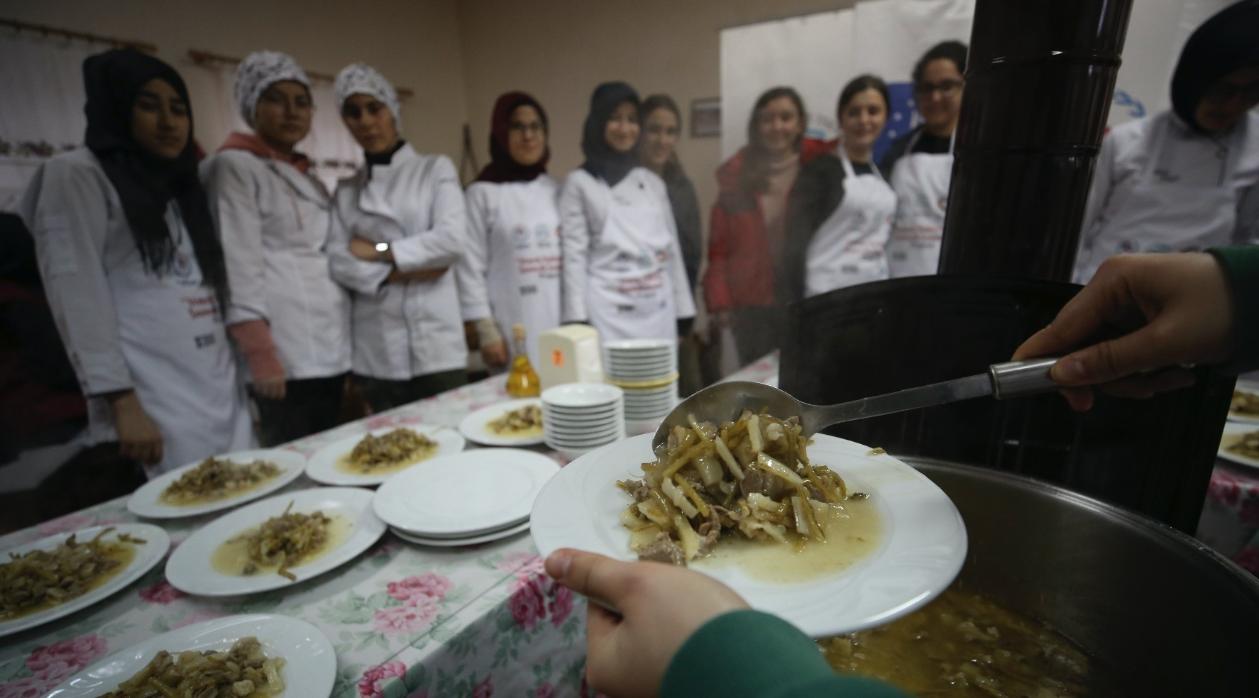 Students learn how to cook 10 regional dishes from local women in 10 different villages.