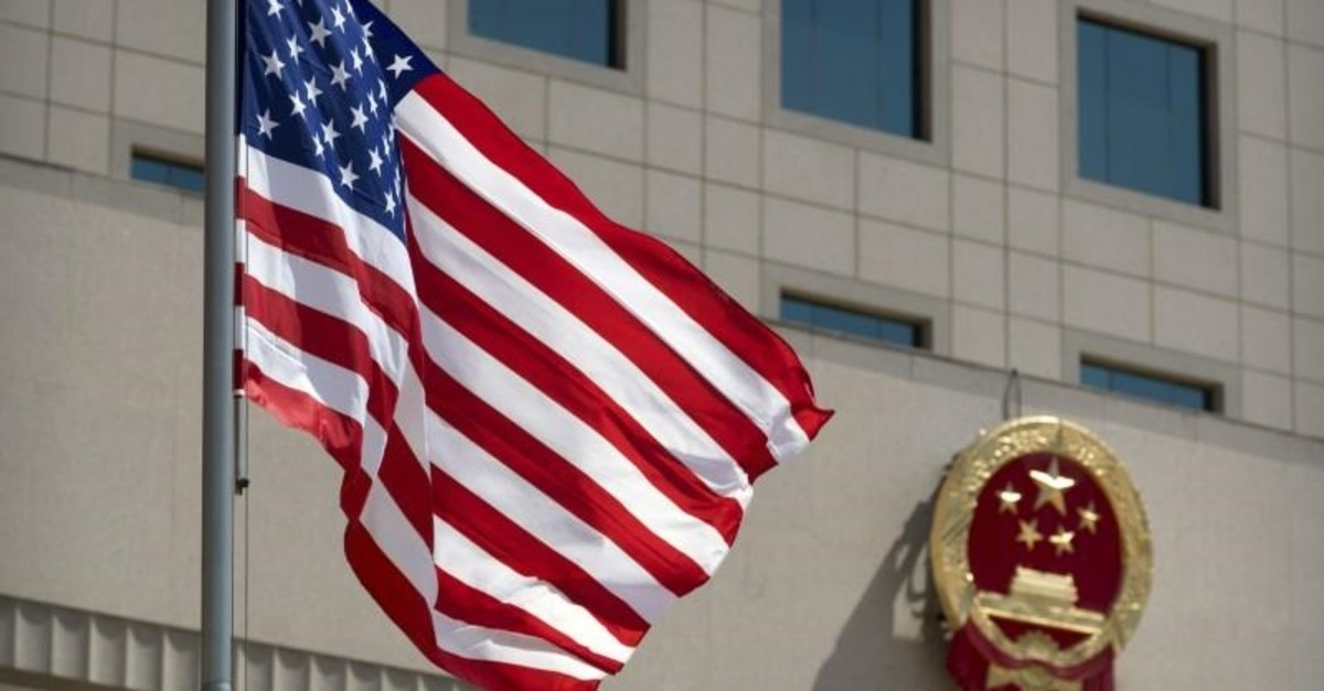 The American flag flies near the national emblem of China outside of the Bayi Building in Beijing, Wednesday, June 27, 2018. (Reuters Photo)