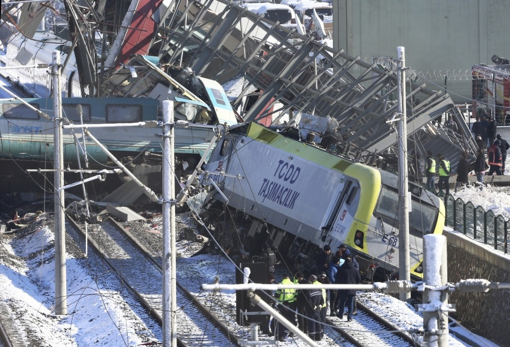 Workers clear the debris after the train crash.