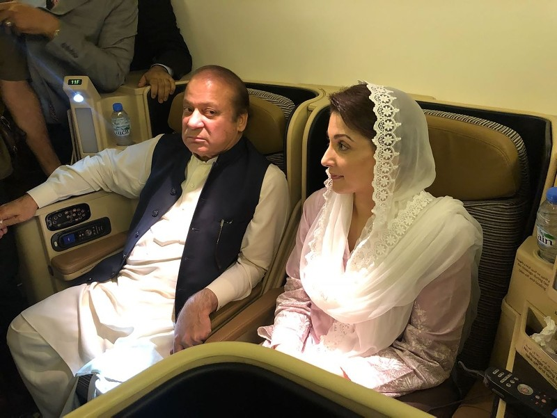 This handout photograph released by Pakistan Muslim League Nawaz (PML-N) party on July 14, 2018, show former prime minister Nawaz Sharif (L) and his daughter Maryam Nawaz siting on a plane after their arrival in Lahore. (AFP Photo)
