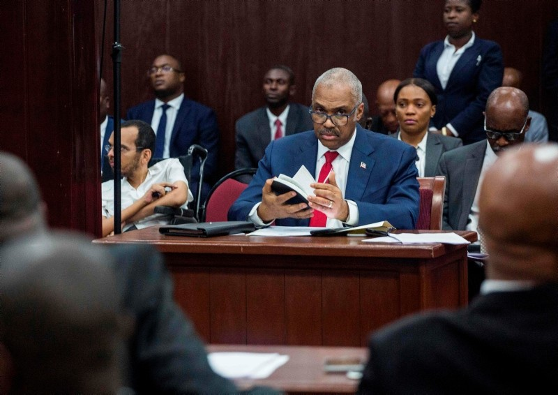 Prime Minister Jack Guy Lafontant in his place in Parliament for the interpellation session at the Chamber of Deputies in Port-au-Prince, Haiti. (AFP Photo)