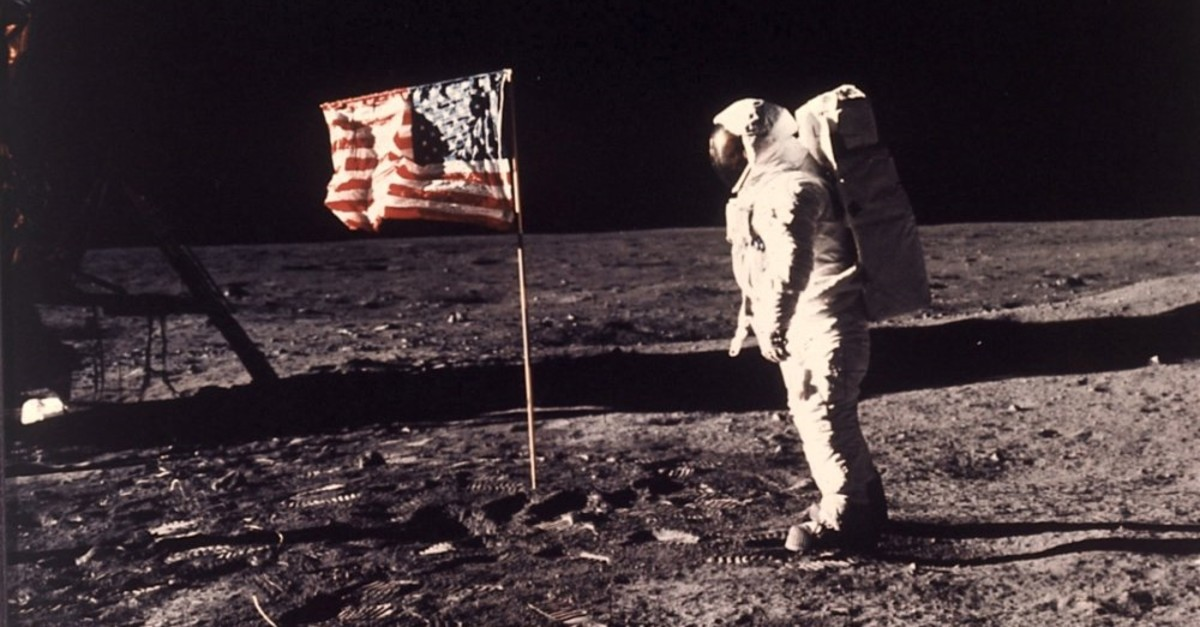 The famous photo of Neil Armstrong landing on the moon and erecting the American flag.