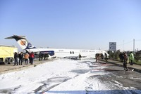 Iranian airliner overruns runway, stops on highway