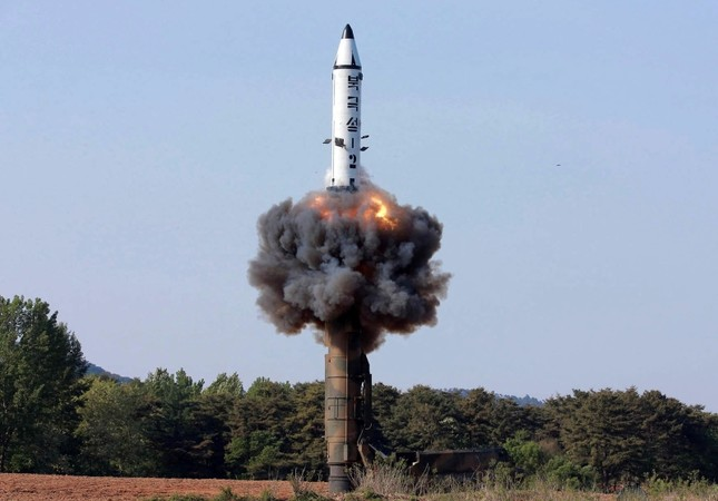 In this undated file photo distributed by the North Korean government on May 22, 2017, a solid-fuel Pukguksong-2 missile lifts off during its launch test at an undisclosed location in North Korea. (Korean Central News Agency/ via AP)