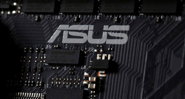 This Feb 23, 2019, photo shows the inside of a computer with the ASUS logo in Jersey City, N.J. Security researchers say hackers infected tens of thousands of computers from the Taiwanese vendor ASUS with malicious software for months. (AP Photo)