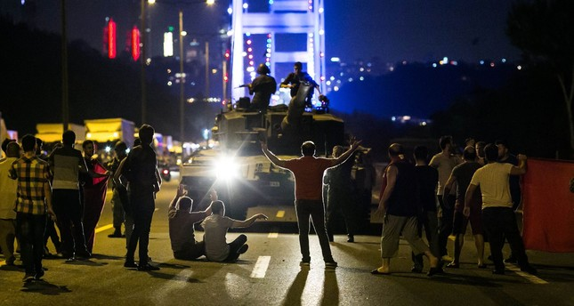 People take over a tank occupied by pro-coup troops near the Fatih Sultan Mehmet bridge on July 15, 2016.