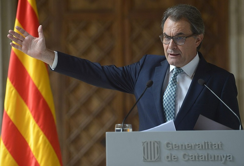 Cataloniau2019s Regional President Artur Mas gestures during a press conference at the Generalitat Palace in Barcelona, Spain, Tuesday, Oct. 14, 2014. (AP Photo)