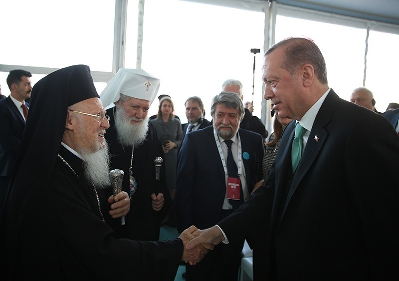 File photo shows President Recep Tayyip Erdou011fan shaking hands with leaders of the Bulgarian Orthodox Church in Istanbul. (AA Photo)