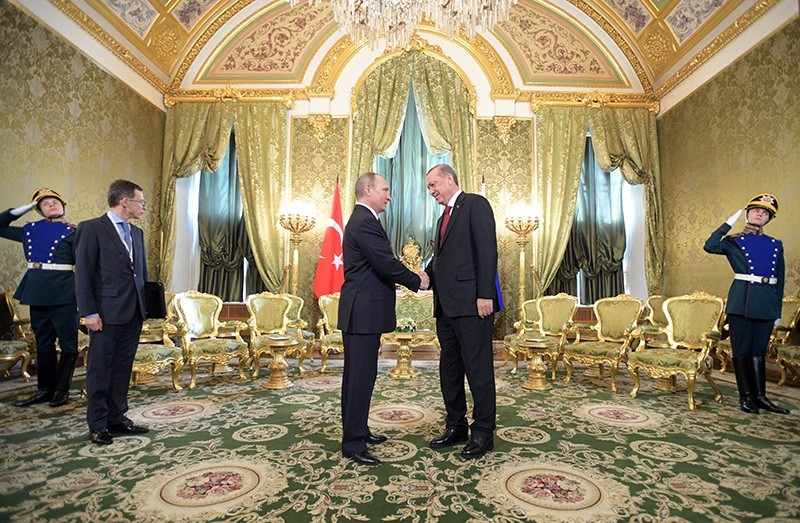 Russian President Vladimir Putin (L) shakes hands with Turkish President Recep Tayyip Erdou011fan (R) prior to the sixth meeting of the High-Level Russian-Turkish Cooperation Council in the Kremlin in Moscow, Russia, March 10, 2017. (EPA Photo)