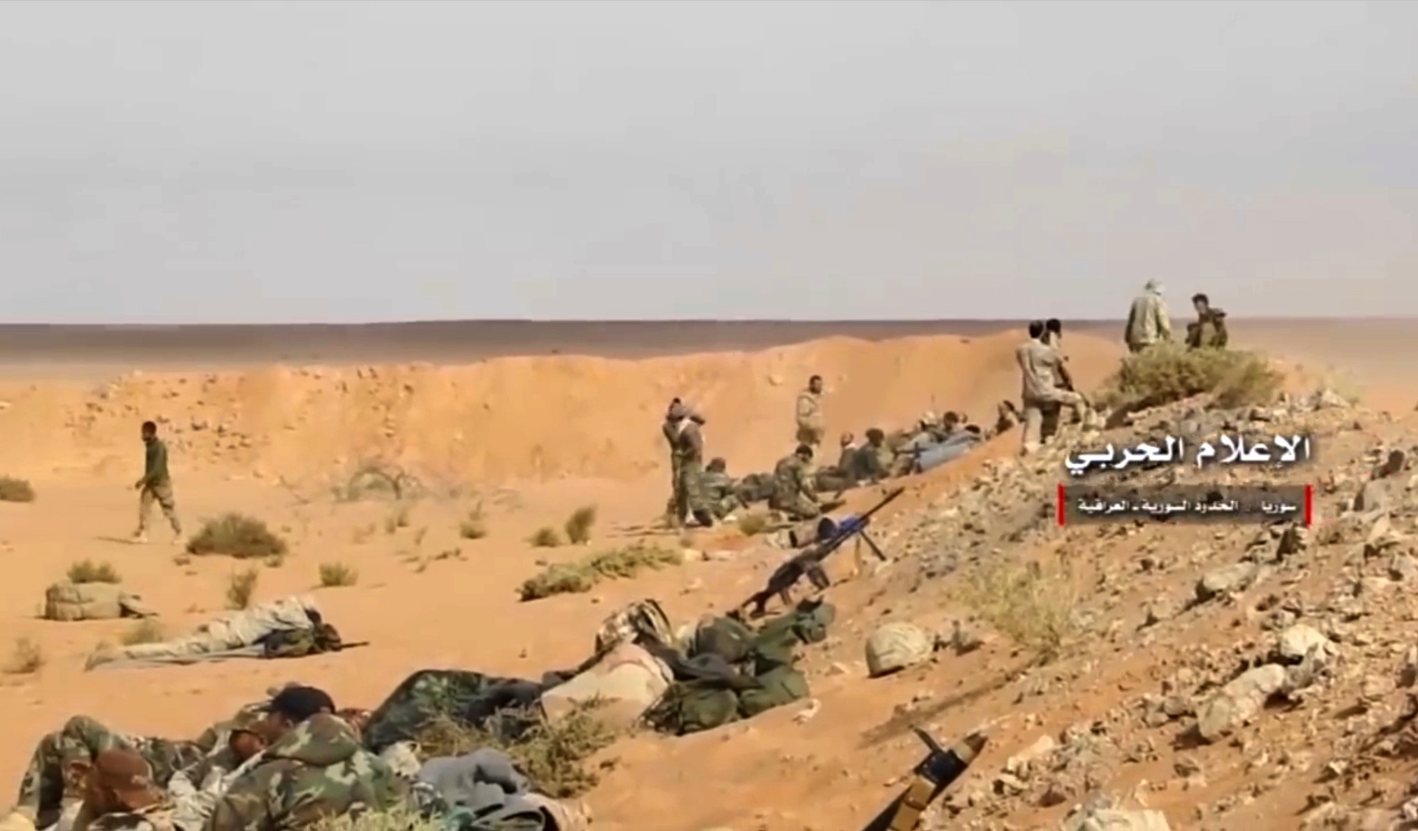 This frame grab from video provided Wednesday, Nov 8, 2017 by the regime-controlled Syrian Central Military Media, shows Assad troops taking up positions on the Iraq-Syria border.