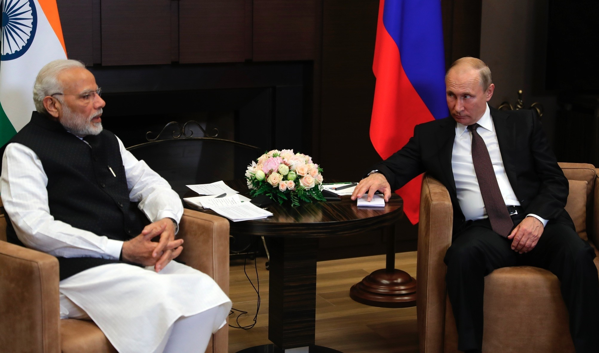 Russian President Vladimir Putin listens to Indian Prime Minister Narendra Modi (L) in the Bocharov Ruchei residence, Sochi, May 21.