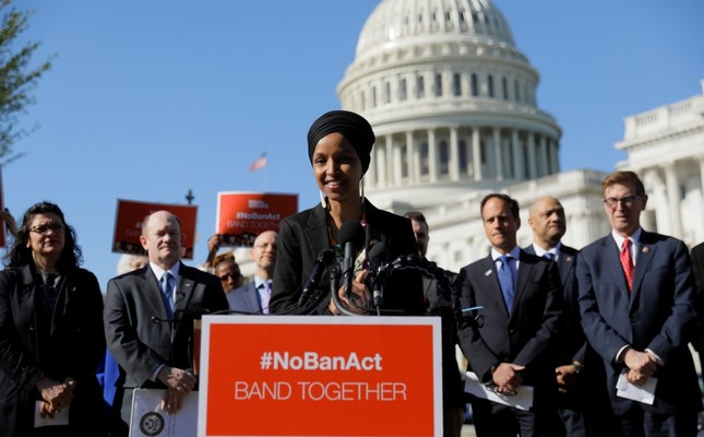 U.S. Representative Ilhan Omar (C) speaks about the Trump administration's policies toward Muslim immigrants at a news conference held by members of the U.S. Congress, outside the U.S. Capitol in Washington, April 10, 2019.