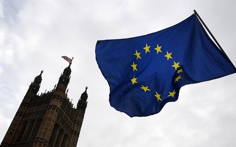 The EU flag outside parliament in London, Britain, 13 December 2017. (EPA Photo)