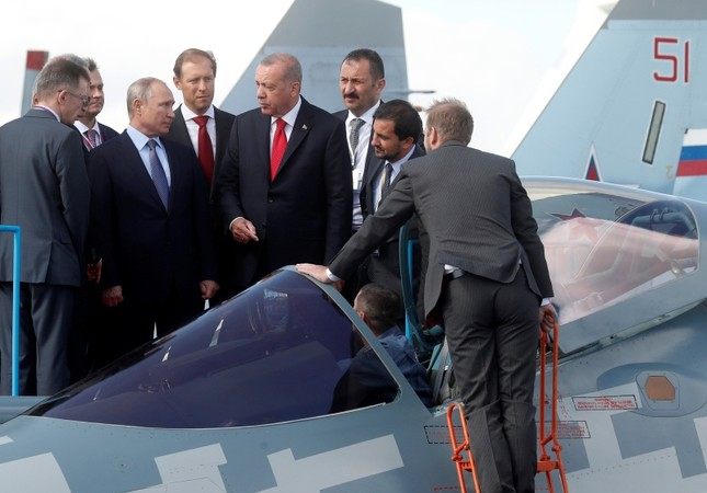 Russian President Vladimir Putin, Russian Industry and Trade Minister Denis Manturov and Turkish President Recep Tayyip Erdoğan inspect a Sukhoi Su-57 fighter during the MAKS-2019 in Moscow, Russia, Aug. 27, 2019. (Maxim Shipenkov/Pool via Reuters)