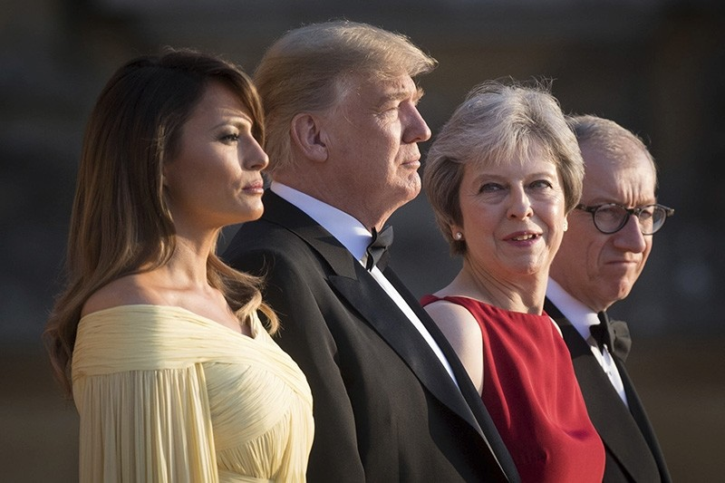 From left, first lady Melania Trump, President Donald Trump, British Prime Minister Theresa May, and her husband Philip May, watch the arrival ceremony at Blenheim Palace, in Blenheim west of London, England, Thursday, July 12, 2018. (AP Photo)