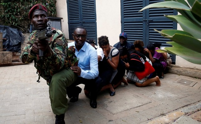 People are evacuated by a member of security forces at the scene where explosions and gunshots were heard at the Dusit hotel compound, in Nairobi, Kenya Jan. 15, 2019. (Reuters Photo)