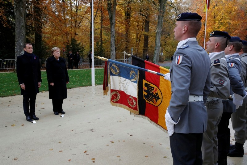 Macron and Merkel inspect a joint military brigade made up of troops of both side, in the Clairiere of Rethondes during a commemoration ceremony for Armistice Day, 100 years after the end of WWI, in Compiegne, France, Nov. 10, 2018. (AP Photo)