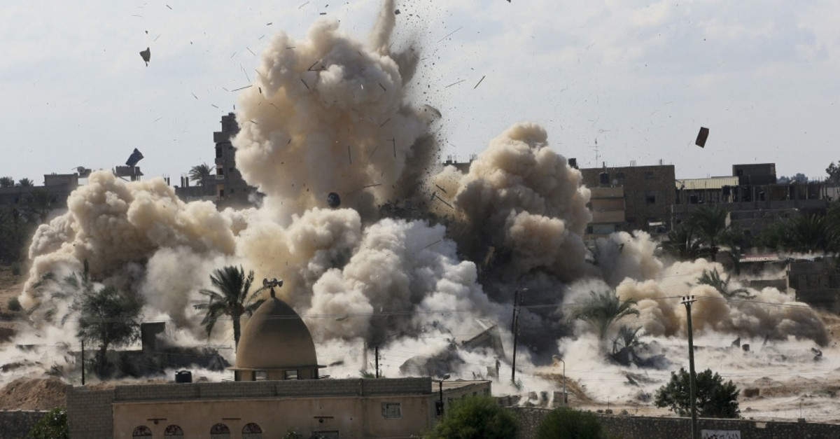 Smoke rises after the Egyptian army demolished houses on the Egyptian side of the border town of Rafah, Oct. 29, 2014.