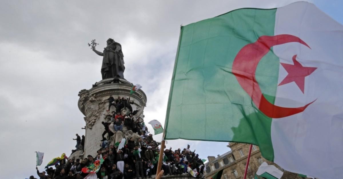 Protestors hold Algerian flags as they attend a demonstration against President Abdelaziz Bouteflika on the Place de la Republique, in Paris, France, March 10, 2019. (REUTERS Photo)