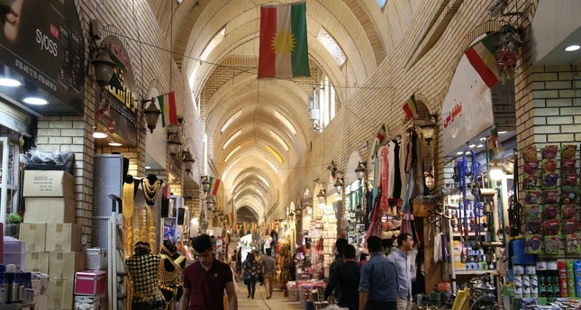 People walk through an alley in an old market, Irbil, KRG, Iraq.