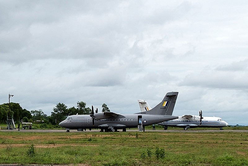 A Myanmar Air Force plane (L) is pictured at Dawei Airport on June 8, 2017, the day after a military plane disappeared off the coast of Launglon, in southern Myanmar. (AFP Photo)