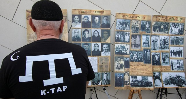 A man looks at an exhibition at a rally, commemorating Crimean Tatars mass deportations from the region in 1944, in the village of Siren, in Bakhchisaray district, Crimea, May 18, 2019. Reuters Photo