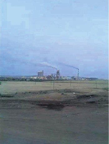 A geo-tagged image of Lafarge plant captured in Jan. 2018 shows smoking chimneys.
