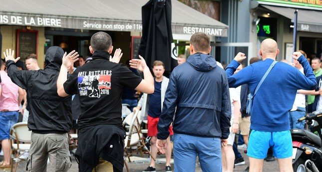 Russian football fans taunt Slovakian fans sitting in a cafe in the city of Lille on June 14, 2016. (AFP Photo)