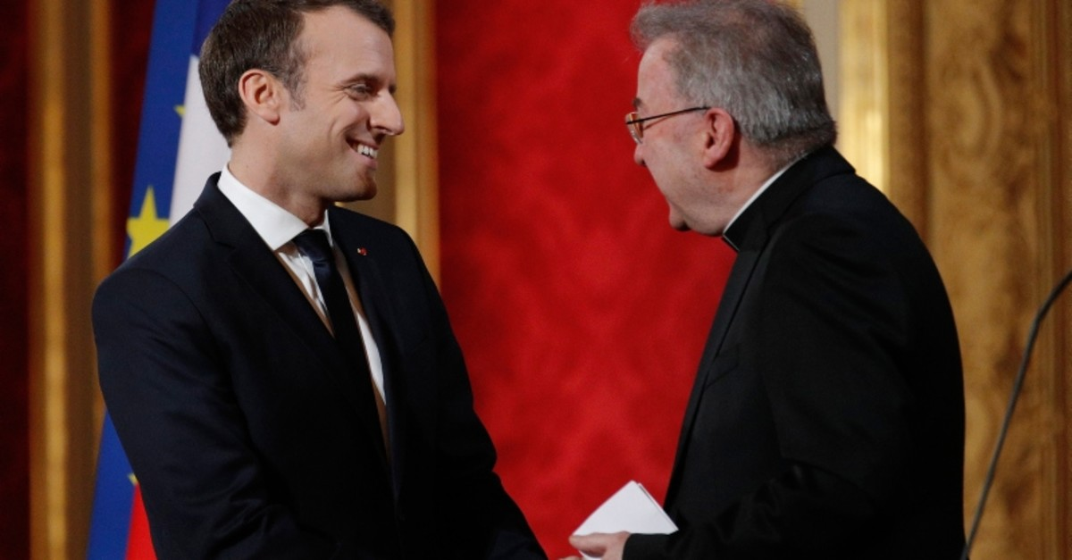 In this Jan.4, 2018 file photo, French President Emmanuel Macron, left, greets Apostolic Nuncio to France Luigi Ventura during his New Year address to diplomats at the Elysee Palace in Paris (AP Photo)